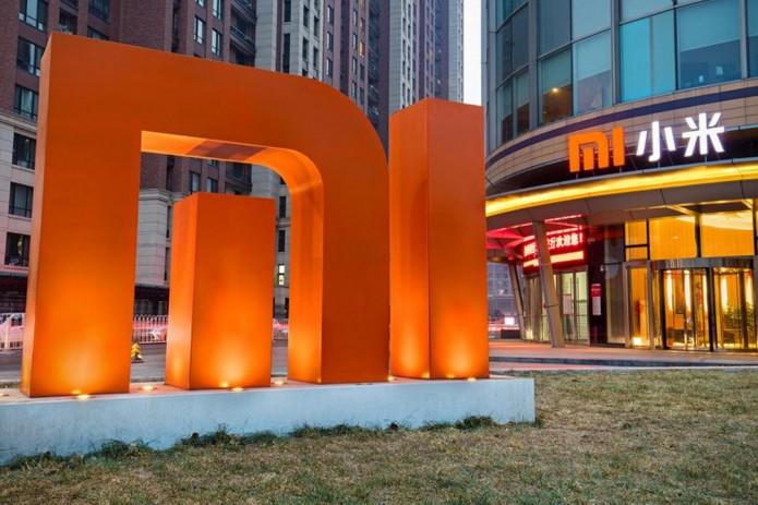 Smartphone maker Xiaomi begins trading in Hong Kong, shares fall 6 percent